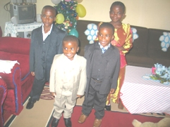 Kids of a family happily displaying their xmas outfits
