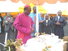Mgr. Joseph Atanga admires one of the numerous anniversay cakes (12)