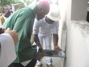 Bishop Bushu laying foundation stone of ARCH Mutengene