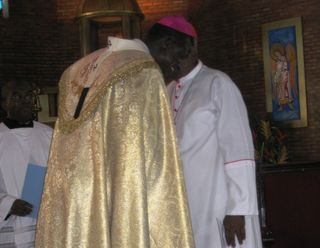 Mgr. Kleda expressing brotherly love to Cardinal Tumi