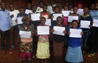 Participants displayed their certificates at the end of the workshop