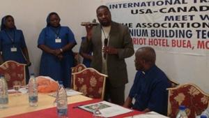 DEREK Lloyd presenting a gift to the Bishop