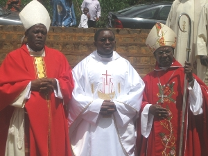 Newly ordained flanked by Bishop Bushu and Archbishop Esua