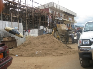 Using part of busy road to store constrution material and disrupting easy traffic flow