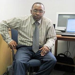 Dr Ernest Molua