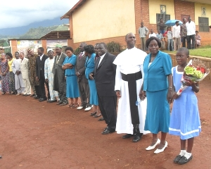 Pupil and Administrative staff await the minister's arrival