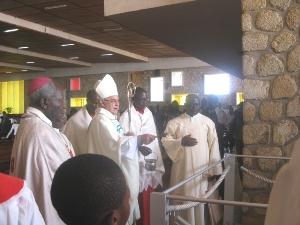 Cardinal Miloslav blesses Late Archbishop Paul Verdzekov's grave