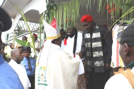 Bishop shaking hands with traditional ruler