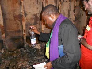 Seafarers chaplain blessing charred remains of burnt seafarer
