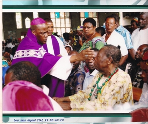 Bishop Bushu annoits a sick person