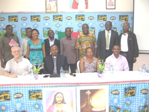 Parish priest, panellists and participants at the end of the conference