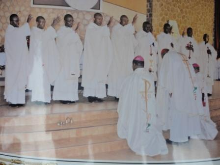 Newly ordained priests bless the concelebrating Bishops