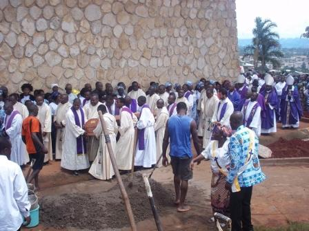 Some priests conveying Mgr. James Nsokika's remains to his final resting place