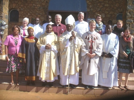 Bishop and German delegation after Mass
