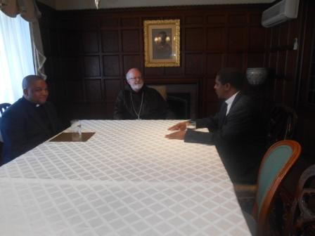 Bishop Nkea Holds talks with Cardinal M'Malley while Fr. Maurice Agbaw Ebai looks on